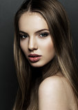 Beautiful woman model portrait with long hair on black