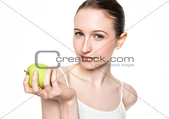 Beautiful fitness women holding healthy apple