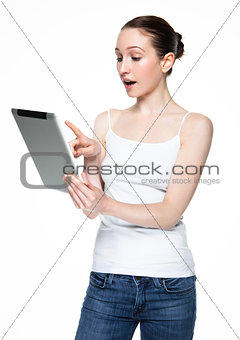 Beautiful woman browsing internet on tablet
