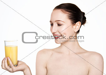 Beautiful woman holding glass with orange juice