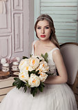 Beautiful young bride with flowers  romantic decoration