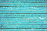 Section of turquoise blue wood panelling from a seaside beach hut.
