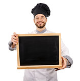 smiling chef holding blank blackboard in front