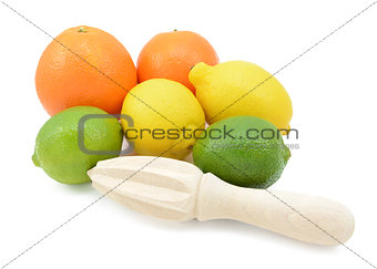 Six citrus fruits with a wooden reamer