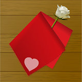 Teat towel folded on a rose on wood background