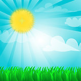 Sunny background with sun and grass.
