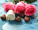 Pink flowers of roses and candy hearts for Valentines holiday