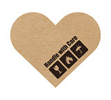 Handle with care symbols on craft paper or cardboard heart