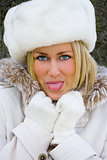 Blond Woman Girl White Fur Hat, Coat Sticking Out her Tongue