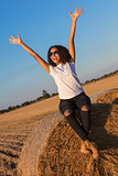 Mixed Race African American Girl Teen Sunglasses on Hay Bale