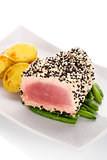 Tuna steak with beans and potatoes.