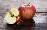 wet fresh red apple on wood background