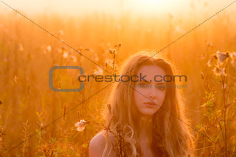 Portrait of beautiful girl in fog