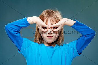 Boy Looking Through Fingers as Binoculars
