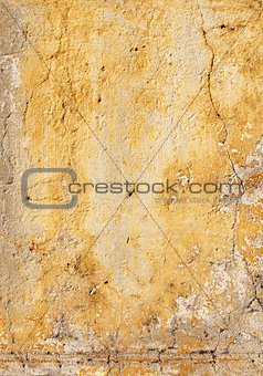 Old stucco wall texture of yellow color