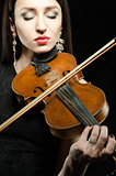 Portrait of a young woman who plays the violin