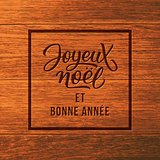 Joyeux Noel text wood. Christmas greeting card