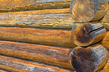 Fragment of the wall of an old log house