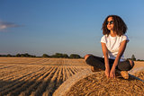 Mixed Race African American Girl Teen Sunglasses Sitting on Hay