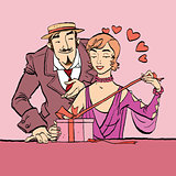 Love and romance. Retro woman opens the gift