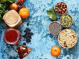 Still life super food - smoothies, muesli, nuts, berries, chia seeds