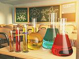 Laboratory glassware with formula on blackdesk in the school che
