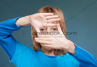 Boy Looking Through a Finger Frame