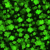 Shine Shamrocks on black backgraund. Seamless