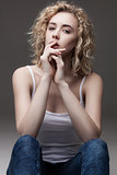 fashion portrait of blond sitting woman