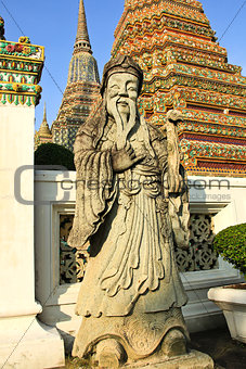 Ancient statue in the complex of Wat Pho, the Temple of the Recl