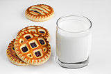 Biscuits with filling and a glass of milk