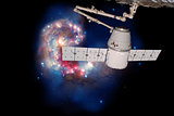 SpaceX Dragon over spiral galaxy.