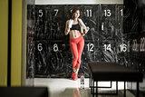 Athletic woman posing in locker-room