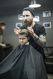 Kid's hair styling in barbershop