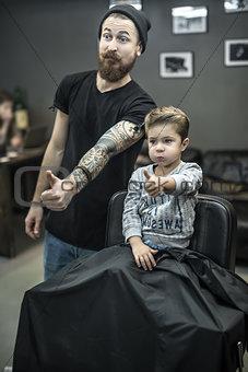 Small kid in barbershop