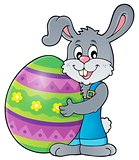 Bunny holding big Easter egg theme 1