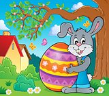 Bunny holding big Easter egg theme 3
