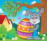 Bunny holding big Easter egg theme 3