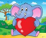 Elephant holding heart theme image 2