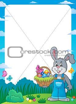Frame with bunny holding Easter basket