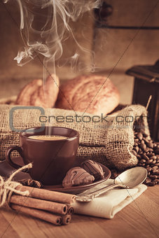 Cup fragrant hot coffee with bean chocolate