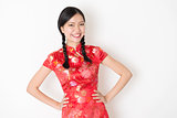 Oriental girl in red qipao smiling