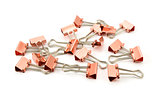 Copper-coloured metal binder clips