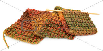 Knitting a scarf in fall colors