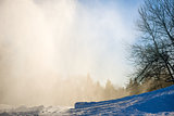 Artificial snow on the piste in natural light