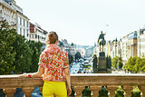 woman on Vaclavske namesti in Prague Czech Republic looking