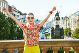 tourist woman on Wenceslas Square in Prague rejoicing