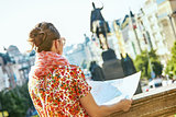 traveller woman on Wenceslas Square in Prague with map