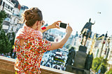 woman in Prague Czech Republic taking photo with mobile phone