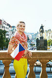 young tourist woman in Prague Czech Republic with Czech flag